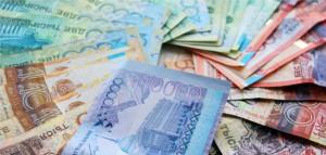Курс тенге на Форекс упал  к юаню, рублю и евро