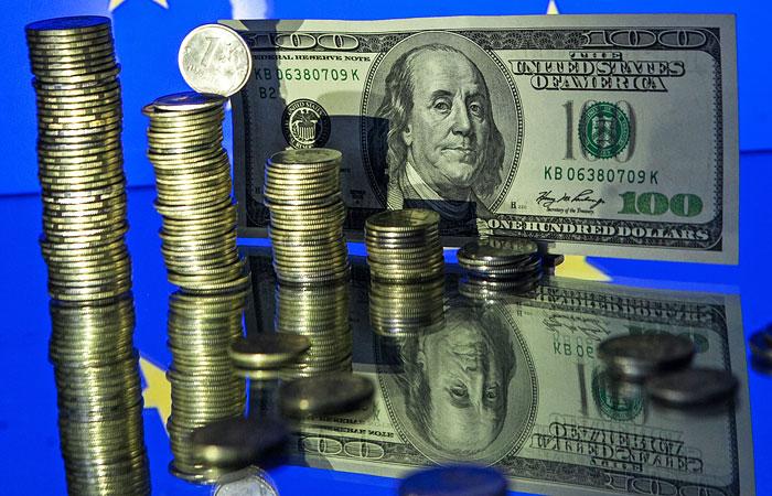 Доллар впервые упал ниже 52 рублей впервые с начала декабря